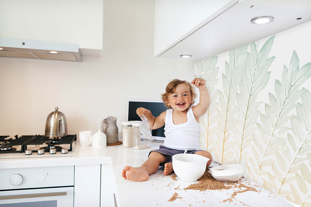 Toddler playing at the kitchen